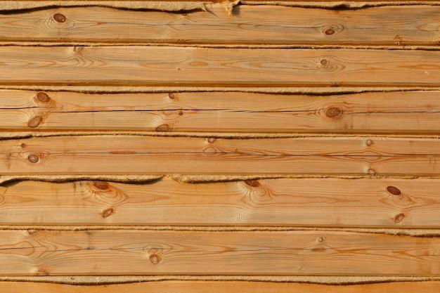 Struttura della plancia di legno per il tuo sfondo. ceppo quadrato in legno