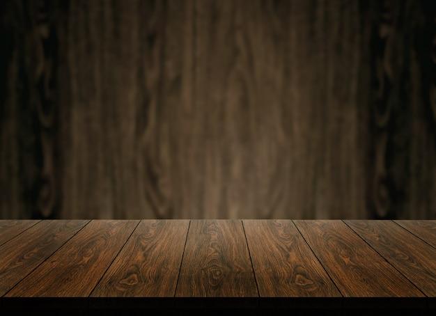 Tavolo in legno davanti alla sfocatura dello sfondo della parete in legno per la visualizzazione del prodotto