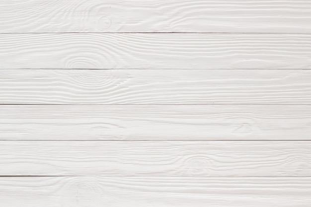 Struttura di legno dipinta con calce, superficie di legno vuota come sfondo