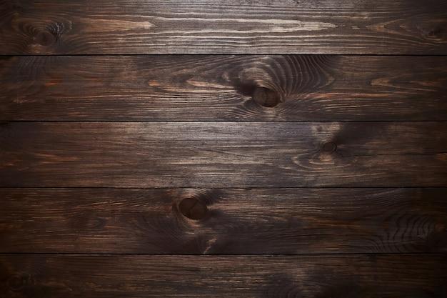 Fondo in legno. tavole verniciate marrone. struttura in legno. vista dall'alto