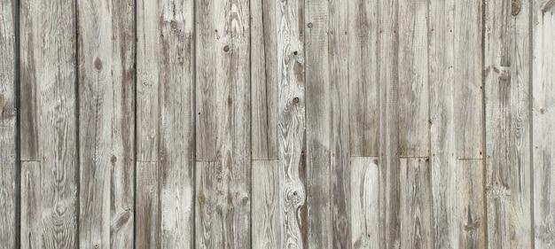 Sfondo di legno con legno stagionato e chiodi arrugginiti