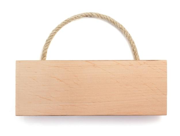 Tavola di legno isolata su priorità bassa bianca