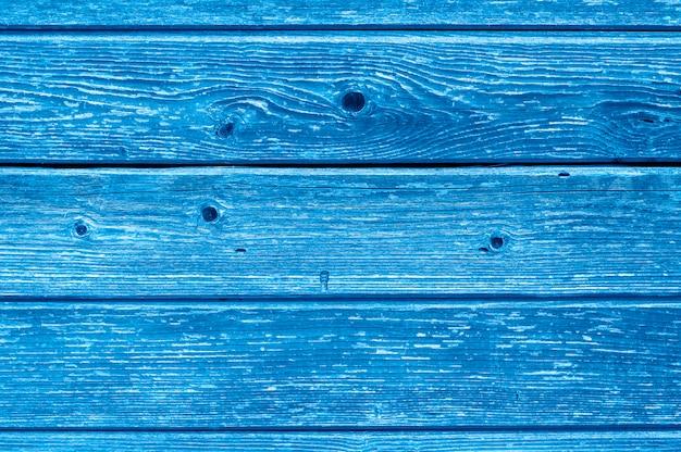Sfondo di assi di legno. assi di legno grige stagionate invecchiate. tonalità blu tonica