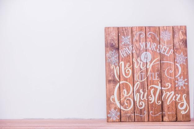 Tavole di legno con iscrizione di natale