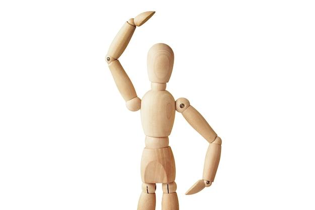Bambola in legno con gesto isolato su sfondo bianco. il manichino mostra il gesto. figura di essere umano in legno con copia spazio