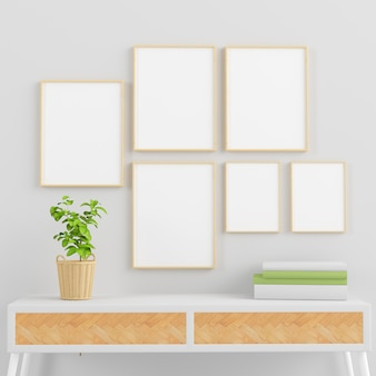 Cornici in legno mock up collezione su stanza minima con rendering 3d di piante, libri e console