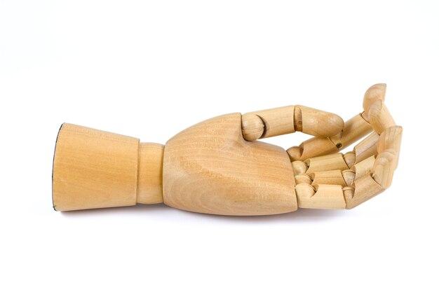 Mani alzate a mano di legno isolate su fondo bianco Foto Premium