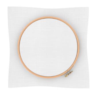 Cerchio in legno per punto croce. un telaio tambour per ricamo e tela con spazio libero per il tuo design su sfondo bianco. rendering 3d