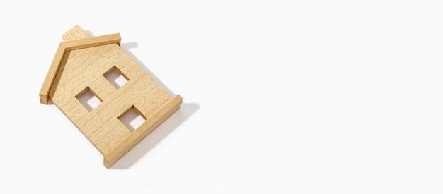 Modello di casa in legno su sfondo bianco. copia spazio