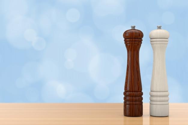 Perrer in legno o salt grinder mills davanti alla parete blu su un tavolo di legno. rendering 3d