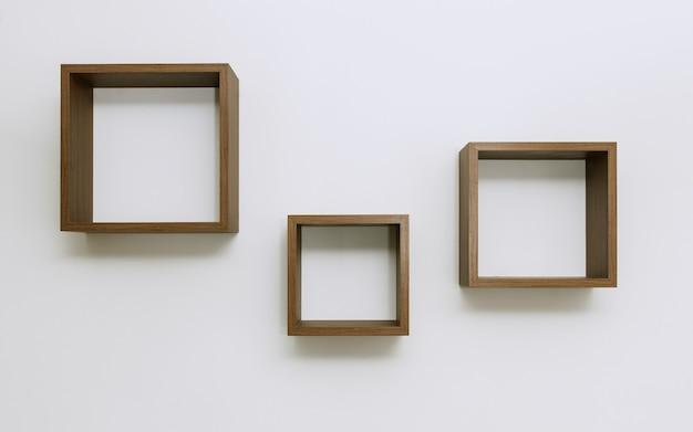 Ripiani in legno impostato sul muro bianco