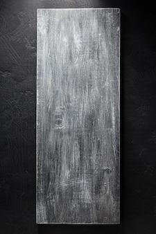 Cartello in legno a trama di sfondo nero