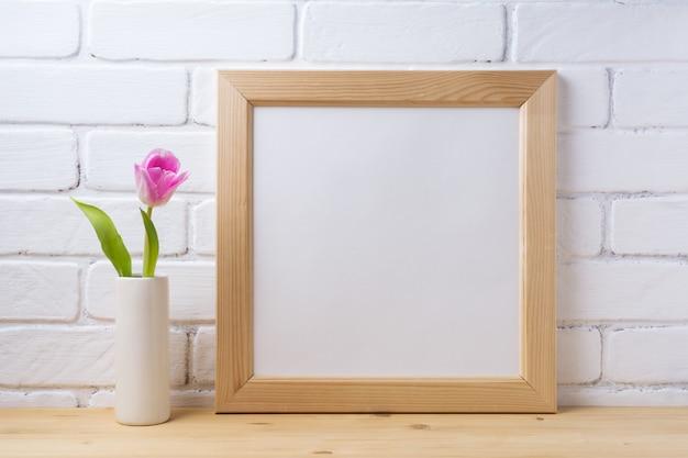 Cornice quadrata in legno con tulipano rosa