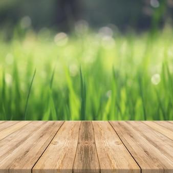 Tavolo in legno in erba all'aperto natura luce solare display quadrato sfondo