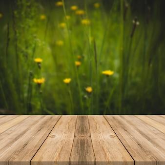 Tavolo di legno in erba all'aperto e fiori gialli natura luce solare piazza display sfondo