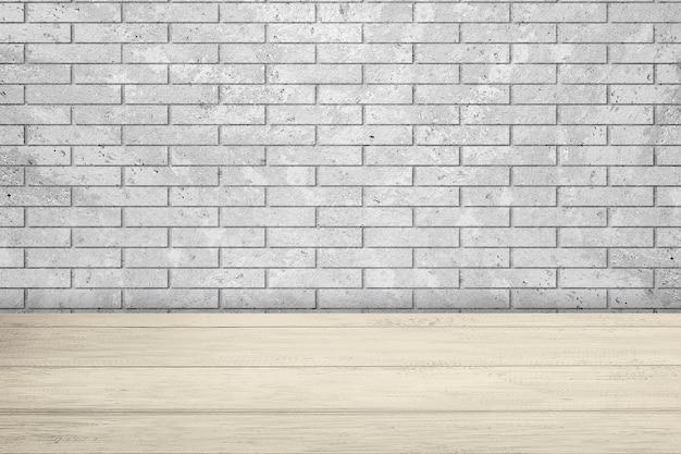 Tavolo in legno con sfondo muro di mattoni grigi