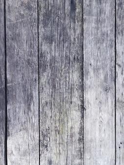 Vista superiore posta il vecchio piano grigio d'annata di legno di legno del copyspace dello scrittorio