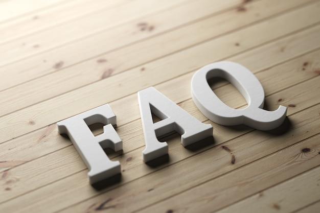 Faq di parola su una tavola di legno con lettere di plastica. rendering 3d.