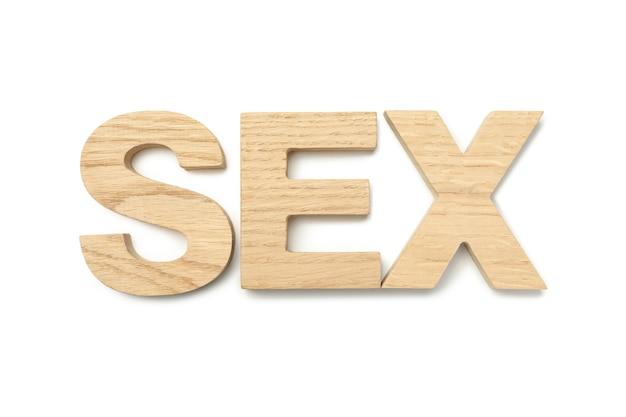 Parola sesso fatta di lettere in legno su superficie bianca