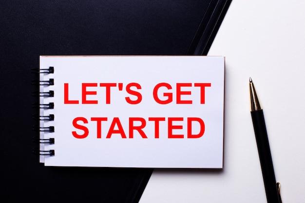 Le parole let is get started scritte in rosso su sfondo bianco e nero vicino alla penna