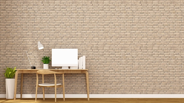 Decorare il posto di lavoro e il muro di mattoni marrone.