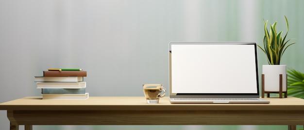 Posto di lavoro o area di lavoro con mockup dello schermo del laptop su un tavolo di legno su sfondo sfocato 3d