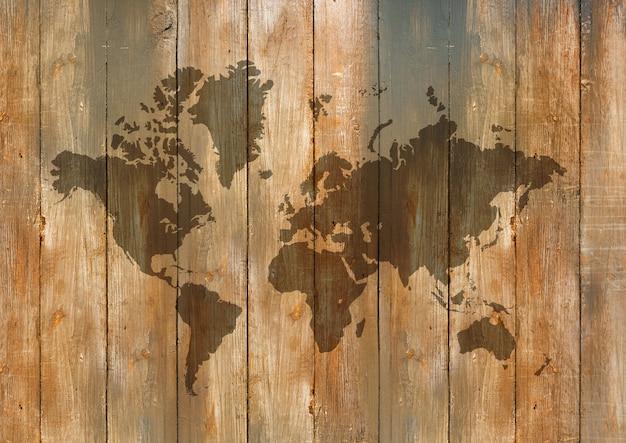 Mappa del mondo isolata sul vecchio fondo della parete di legno