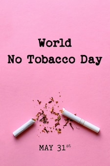 Giornata mondiale senza tabacco scritte su sfondo rosa. smetti di fumare concetto
