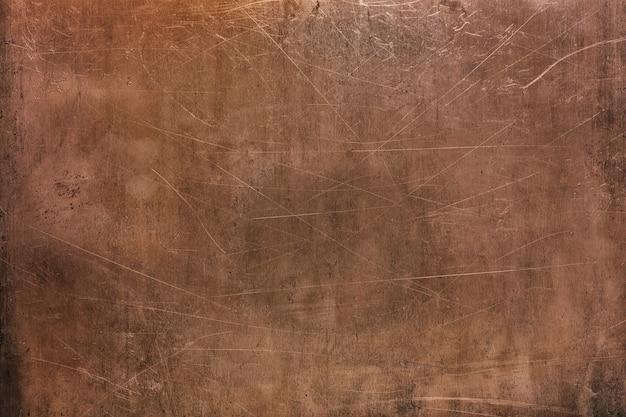 Lamiera usurata di rame, primo piano di struttura metallica, sfondo