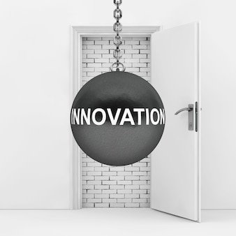 Palla da demolizione con segno di innovazione pronta a distruggere il muro di mattoni che ha bloccato il primo piano estremo della porta