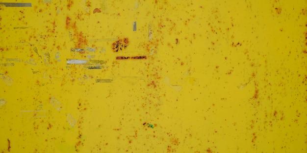 Struttura grungy d'acciaio della ruggine della macchia arrugginita del fondo giallo