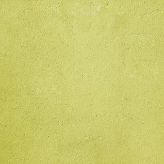 Sfondo giallo con effetto muro di cemento