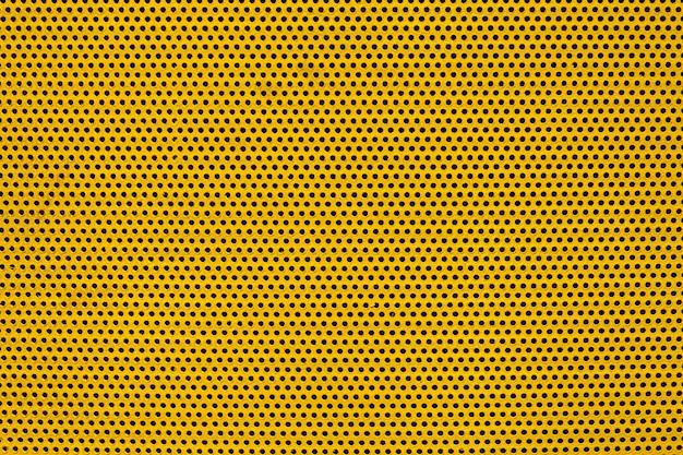 Placca di metallo di colore giallo con molti piccoli fori circolari punti trama per lo sfondo