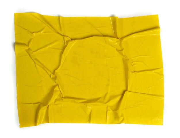 Texture di carta incollata gialla con pieghe effetto grunge di superficie a forma di cornice rotonda e posto per testo
