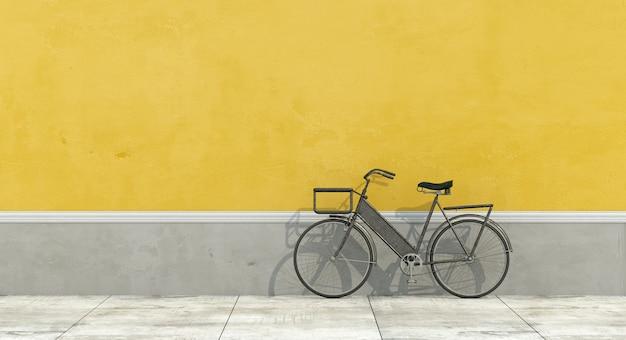 Muro giallo e grigio con bicicletta retrò
