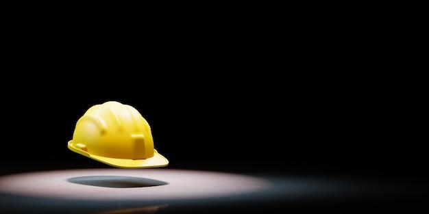 Cappello duro giallo sotto i riflettori isolato Foto Premium
