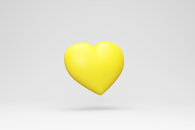 Cuore di amore giallo su sfondo grigio studio