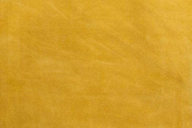 Sfondo con texture morbida al tatto in pelle scamosciata naturale gialla