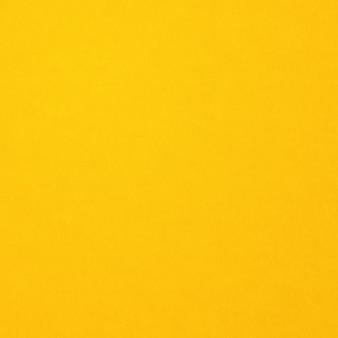Priorità bassa di struttura di carta gialla. carta da parati quadrata pulita