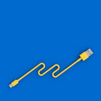 Cavo usb giallo su sfondo blu in stile flatlay.