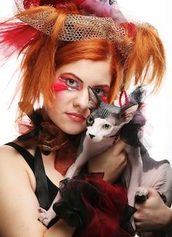 Principessa yong con gatto. trucco di fantasia creativa. Foto Premium