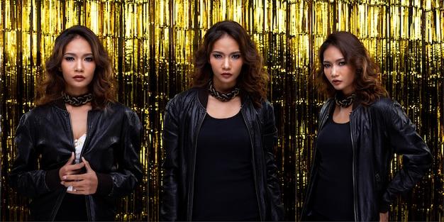 I bei capelli ricci di alta moda della giovane donna asiatica indossano un abito blazzer nero nel periodo del capodanno dell'anniversario del partito. illuminazione da studio tenda a lamina dorata sfondo spazio copia, collage gruppo pack concept