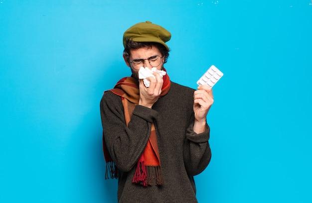 Concetto di malattia del giovane uomo barbuto. raffreddore e influenza