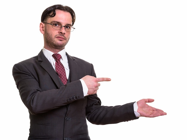 Giovane imprenditore puntare il dito mentre mostra s