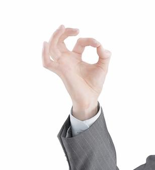 Giovane imprenditore che mostra segno ok. isolato su uno sfondo bianco. foto con copia spazio