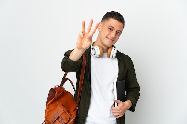 Uomo giovane studente caucasico isolato sul muro bianco felice e contando tre con le dita