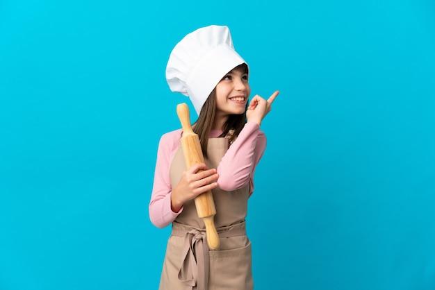 Giovane chef su sfondo isolato