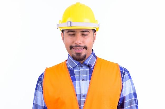 Giovane bello barbuto operaio edile iraniano uomo isolato su bianco