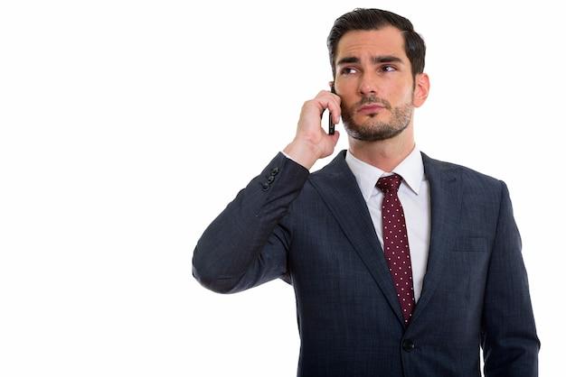 Giovane uomo d'affari bello pensare mentre guarda