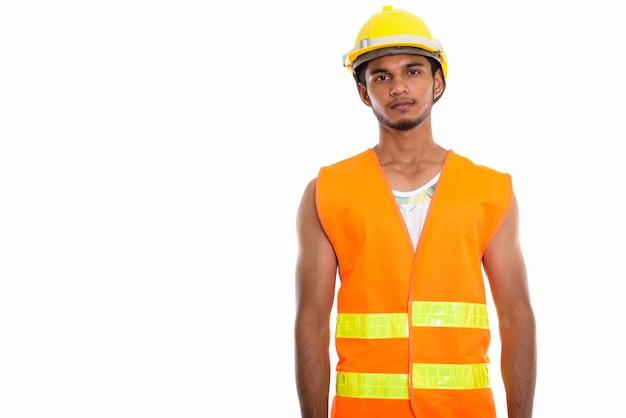 Giovane uomo indiano bello operaio edile